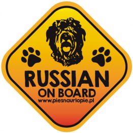 Naklejka na samochód z psem rasowym (czarny terier rosyjski) idealna dla właściciela, który lubi podróżować z psem i dba o jego bezpieczeństwo. Na prezent dla miłośnika zwierząt czy jako gadżet dla wielbiciela psów.